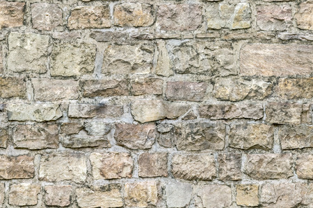 Fragment of an old stone fortress wall for use as an abstract background and texture.