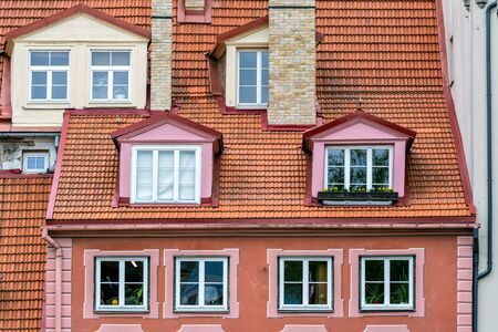 View of the roof of red tiles with attics in the old part of Riga.
