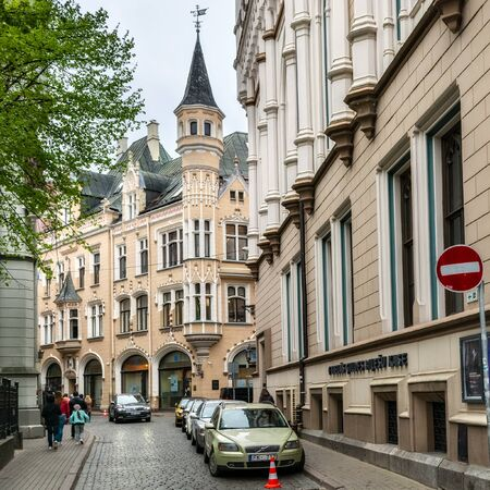 Riga, Latvia, may 02: Tourists walk along cobbled streets and get acquainted with the sights in the old part of Riga, May 02, 2019. Editorial