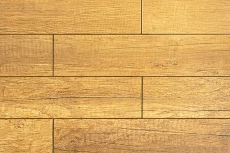Fragment of a floor laid out with a parquet from wooden plates, for use as a texture and an abstract background.
