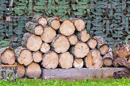 Aspen logs, neatly laid in a crib.