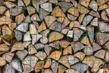 Image of dry wood stored on a metal grill for use as an abstract background. 스톡 콘텐츠