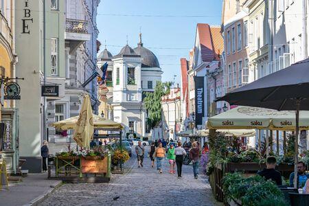 Tallinn, Estonia, June 28: Tourists get acquainted with the sights on the street of Old Tallinn, June 28, 2019.