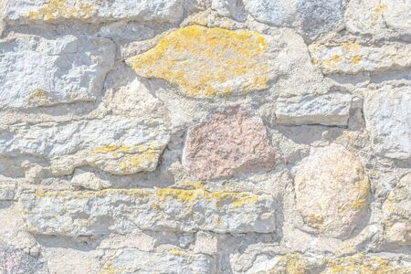 Light fragment of an old stone wall for use as an abstract background and texture.