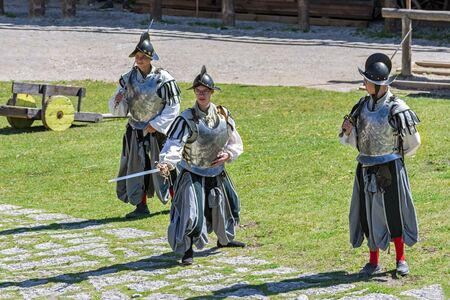 Rakvere, Estonia, June 28: A cuirassier squad staged a show in the courtyard of an old castle in Rakvere, June 28, 2019.
