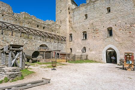 Rakvere, Estonia, June 28: The commander of a cuirassier squad enters the courtyard of an old castle in Rakvere, June 28, 2019. 에디토리얼