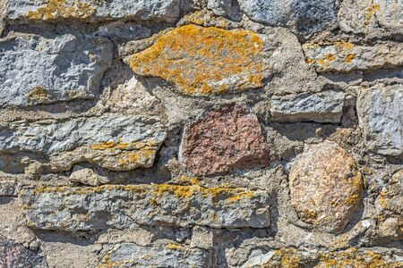 Dark fragment of an old stone wall for use as an abstract background and texture.