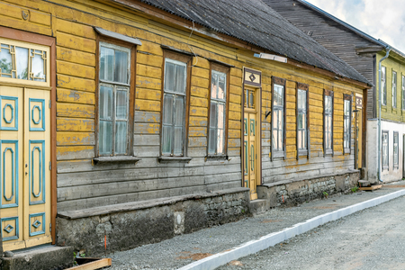 Street of the Estonian city of Rakvere with old wooden houses.