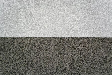 Fragment of a textured wall with light and dark areas for use as an abstract background.