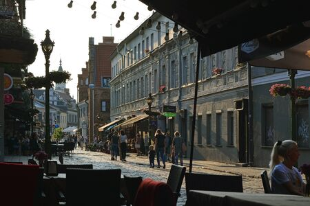 Kaunas, Lithuania, August 30: View of the pedestrian Vilnius street with townspeople strolling along it, from a cozy street cafe, in the evening in the old part of Kaunas, August 30, 2019.