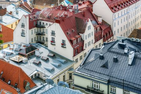 Roofs of the old city of Tallinn in Estonia, taken from the top point on a bright Sunny day.