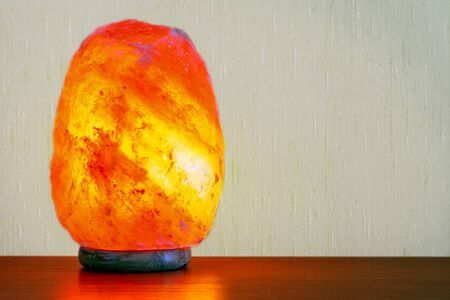 Table lamp made from a single piece of Pakistani rock salt.