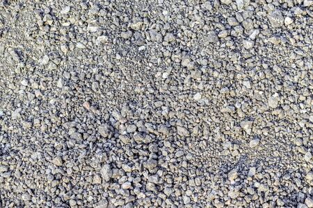 Fragment of the surface of fine gray rubble and gravel. For use as an abstract background. Banco de Imagens