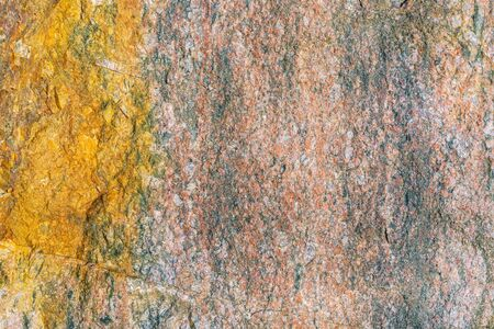 Fragment of the rough surface of a flat stone. For use as an abstract background.