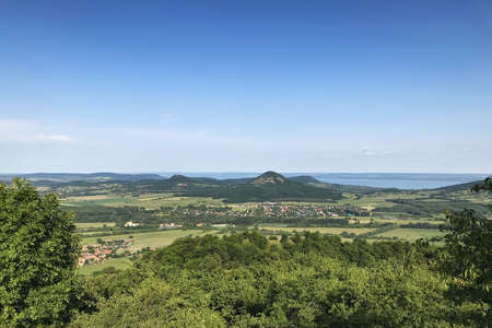 Landscape with the hilly northern shore of Lake Balaton in Hungary on a bright summer day with a cloudless sky.