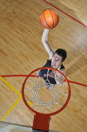one healthy young  man play basketball game in school gym indoor Stock Photo - 5232547