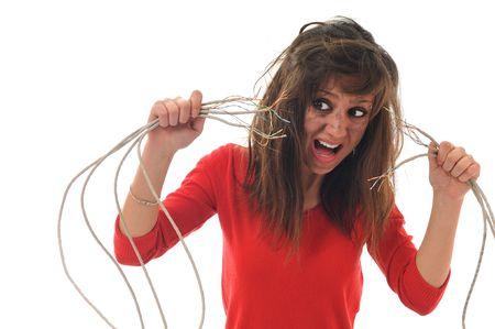 electric shock: mujer joven con la cara oscura de choque el�ctrico explosi�n concepto conectar Foto de archivo
