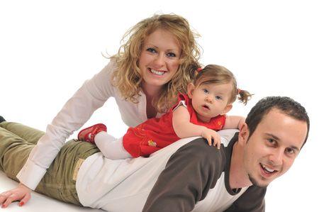 esposas: joven familia feliz con hermoso beb� aislado en blanco Foto de archivo