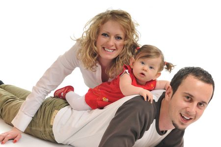 young happy family with beautiful baby isolated on white photo