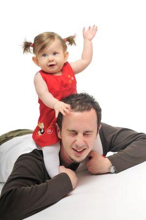 minors: machos j�venes de los padres jugar con el hombre hermoso beb� Foto de archivo