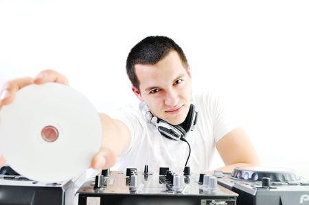 young dj man with headphones and compact disc dj equipment photo