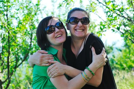 woman pragnant outdoor with friend smile and joy Stock Photo - 5293431