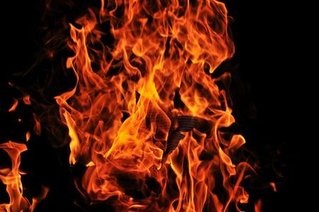 wild fire flames burn hot with black background photo