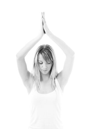 one young fit  woman in white shirt meditating adn exercise  yoga isolated photo