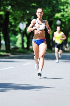 young woman run marathon and recreating fitness sport photo