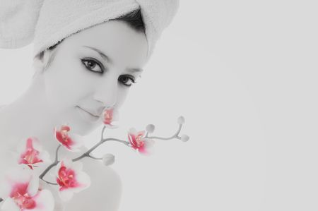 beauty halth and spa wellness isolated young woman face portrait closeup with towel and flower treatment photo