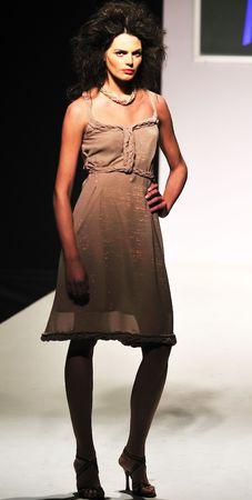 young beautiful model walking on fashion show piste Stock Photo - 5272009