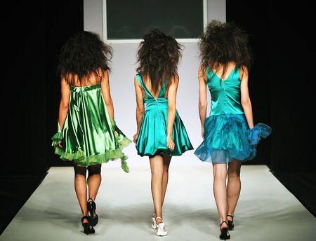 fashion model catwalk: young beautiful model walking on fashion show piste Stock Photo
