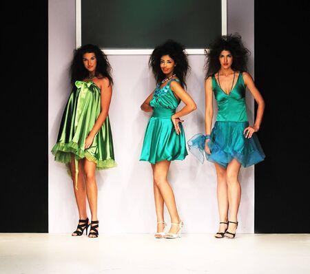 young beautiful model walking on fashion show piste Stock Photo - 5273350