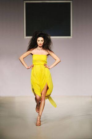 young beautiful model walking on fashion show piste Stock Photo - 5273351