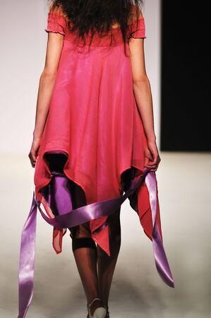 piste: young beautiful model walking on fashion show piste Stock Photo