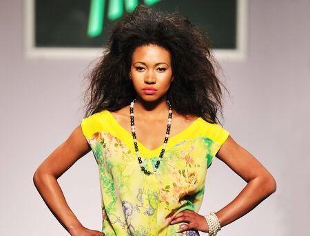 strut: young beautiful model walking on fashion show piste Stock Photo
