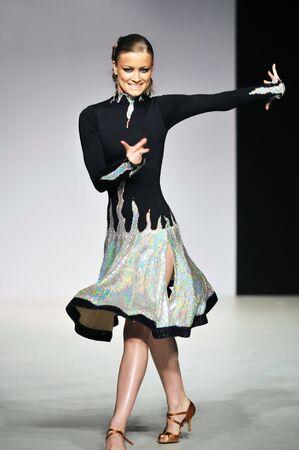 fashion show woman at piste walkinx in luxury dress photo