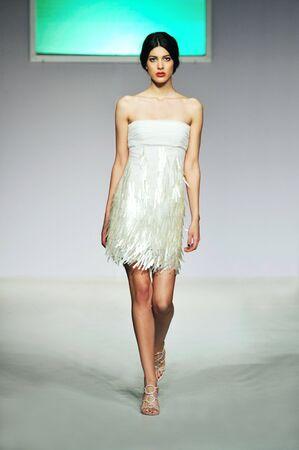 piste: fashion show woman at piste walkinx in luxury dress