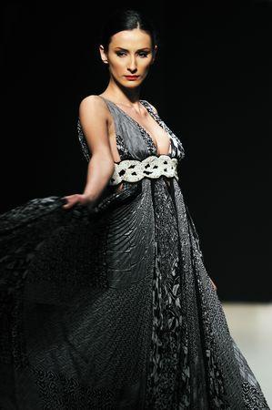 fashion show woman at piste walkinx in luxury dress Stock Photo - 5272348