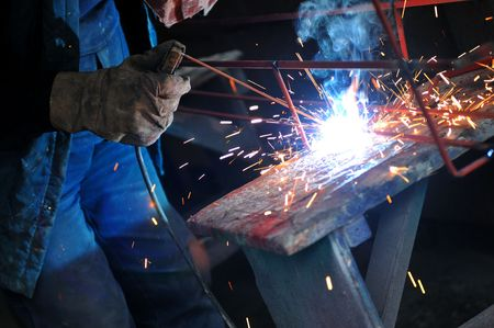 laboring: weld machine worker hard industry business