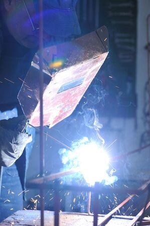weld machine worker hard industry business photo