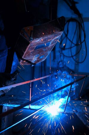 laboring: weld machine worker hard industry businessweld machine worker hard industry business