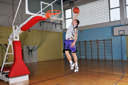 one healthy young  man play basketball game in school gym indoor Stock Photo - 5273134