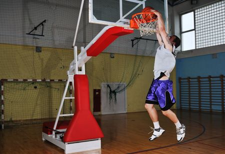 one healthy young  man play basketball game in school gym indoor Stock Photo - 5272518