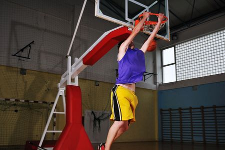 one healthy young  man play basketball game in school gym indoor Stock Photo - 5272781