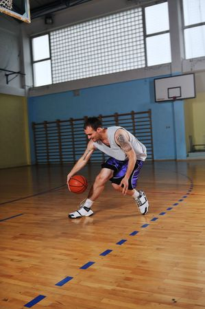 one healthy young  man play basketball game in school gym indoor Stock Photo - 5272791