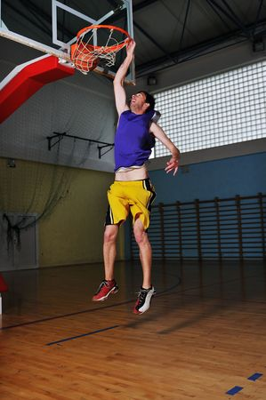 one healthy young  man play basketball game in school gym indoor Stock Photo - 5272598