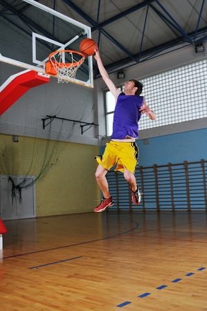 one healthy young  man play basketball game in school gym indoor Stock Photo - 5272600