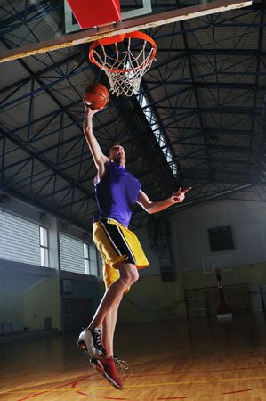 one healthy young  man play basketball game in school gym indoor Stock Photo - 5272587