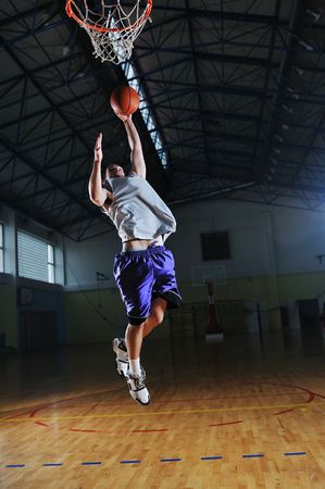 one healthy young  man play basketball game in school gym indoor Stock Photo - 5272619